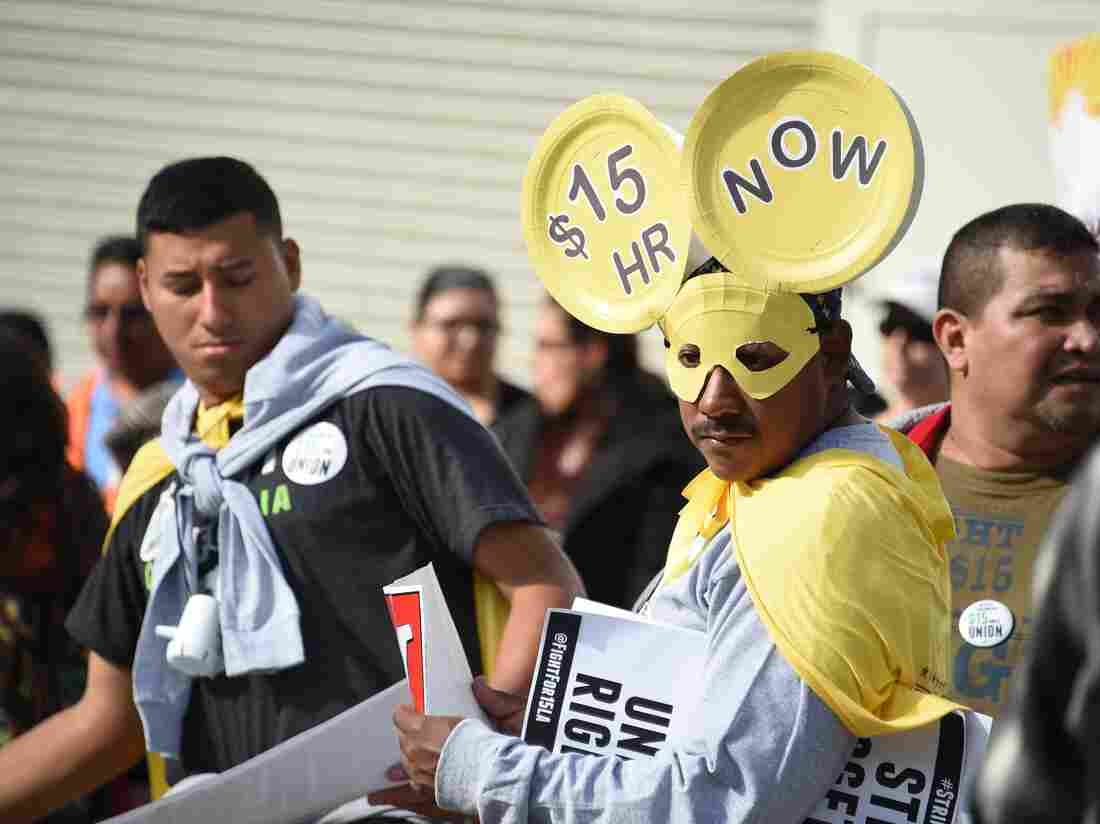 Fast-food workers, health care workers and their supporters shout slogans at a Dec. 4, 2014, rally and march to demand a minimum-wage increase to $15 per hour in Los Angeles.