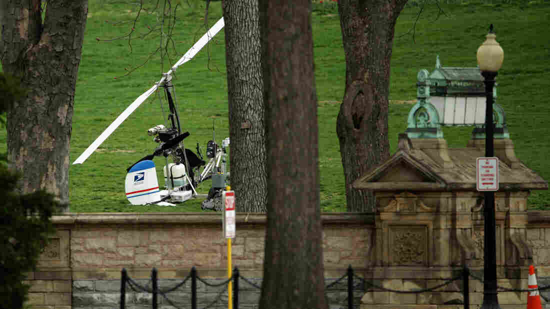A gyrocopter rests April 15 on the west lawn of the U.S. Capitol in Washington. Doug Hughes, a 61-year-old postal worker from Ruskin, Fla., landed the lightweight helicopter on the Capitol lawn to promote campaign finance reform. He's scheduled to enter pleas to multiple charges Thursday.