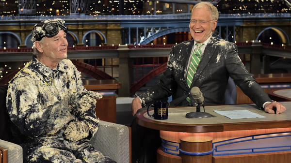 Bill Murray emerged from a cake to give David Letterman a goodbye embrace during Tuesday's taping of The Late Show. Letterman is ending his run as the show's host Wednesday.