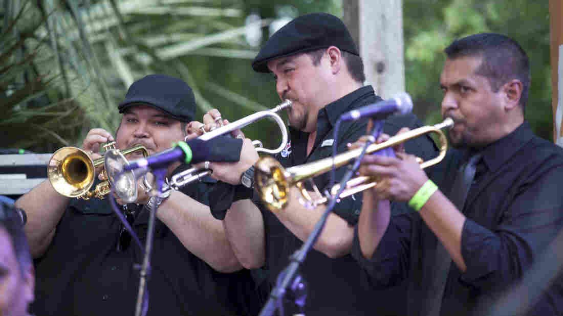 Orkesta Mendoza's horn section belts out classic mambo riffs.