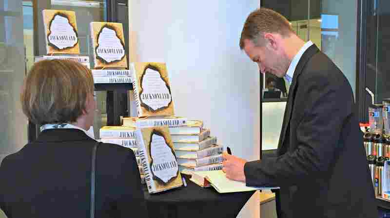 Morning Edition host Steve Inskeep signs a copy of his new book Jacksonland for a fan during a book signing in the NPR gift shop on Tuesday.
