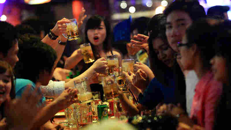 Alcohol consumption is low in Asia — but it definitely happens. Above: Vietnamese friends imbibe at a open-air beer bar in Ho Chi Minh City.
