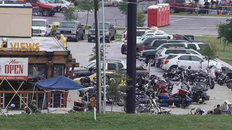 Law enforcement investigate on May 18 the motorcycle gang-related shooting at the Twin Peaks restaurant in Waco, Texas.