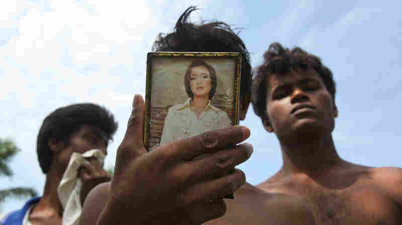 A newly arrived Rohingya migrant uses a mirror after taking a shower at a temporary shelter in Bayeun, Aceh province, Indonesia, on Thursday.