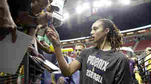 Phoenix Mercury's Brittney Griner stops to sign autographs for fans before a WNBA basketball game against the Seattle Storm in 2013 in Seattle.