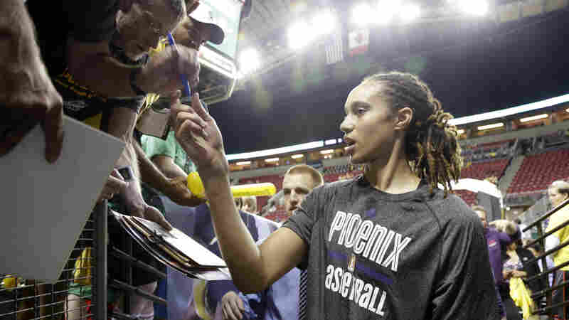 Phoenix Mercury's Brittney Griner stops to sign autographs for fans before a WNBA