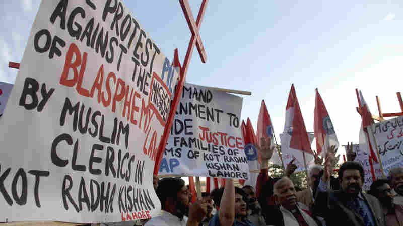 Pakistani human rights activists condemn the killing of the Christian couple for alleged blasphemy during a demonstration in Islamabad, Pakistan, in November.