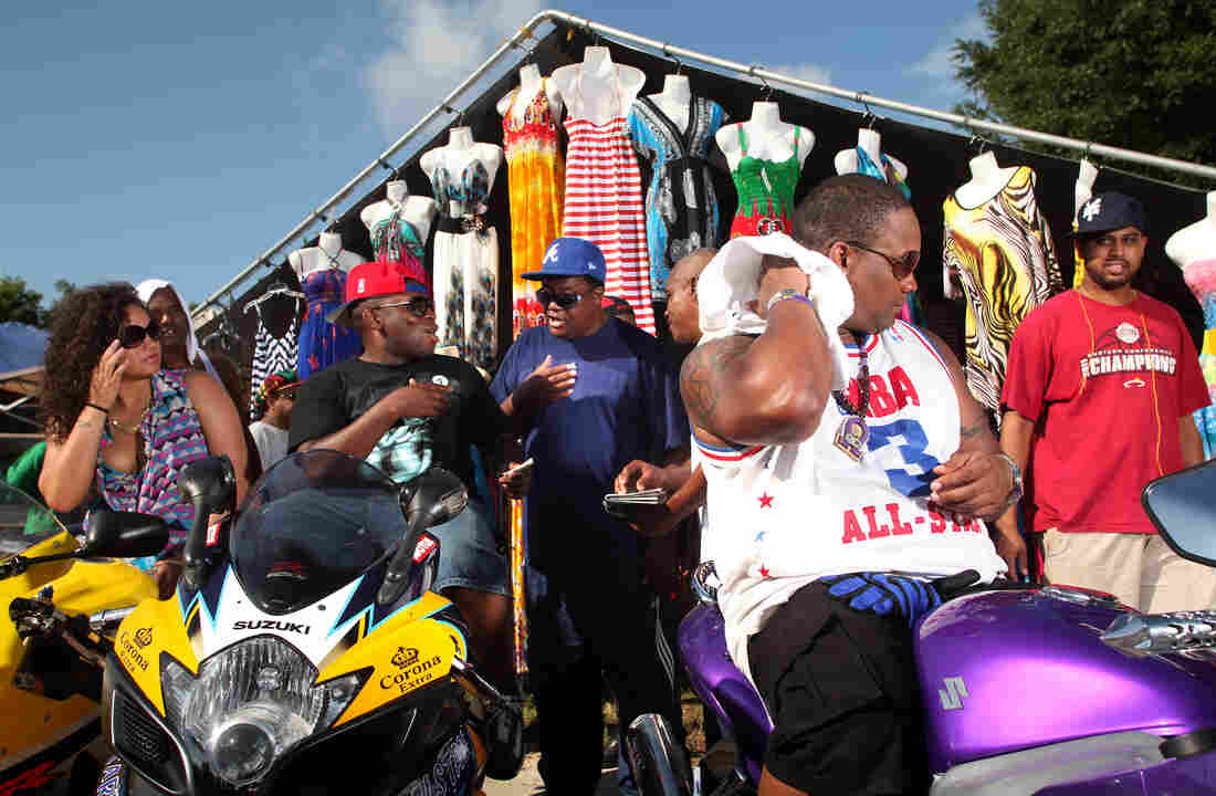 Bryan Paige of Atlanta (second from right) and friends cool off after a long ride at the 2012 Atlantic Beach BikeFest in Atlantic Beach, S.C. The biker festival is one of two rallies in the Myrtle Beach area during the month of May.