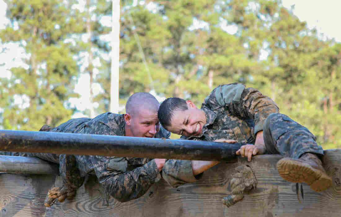 U.S. Army Soldiers conduct the Darby Mile buddy run and an obstacle course during the first gender-integrated Ranger Course at Fort Benning, Ga. Among the 400 students, 19 are women.