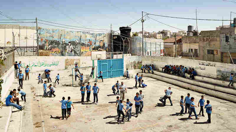 At the Aida Boys School, in the West Bank town of Bethlehem, the walls are extra thick to protect students against bullets.