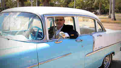 All Things Considered host Robert Siegel in a 1955 Chevrolet Bel Air, undoubtedly rocking out to his own road trip playlist.