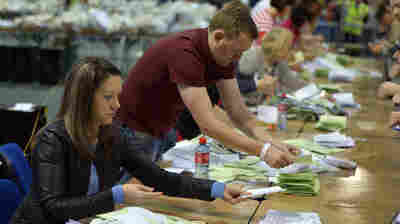 Votes are counted as the ballot boxes are opened Saturday at an election center in Dublin.