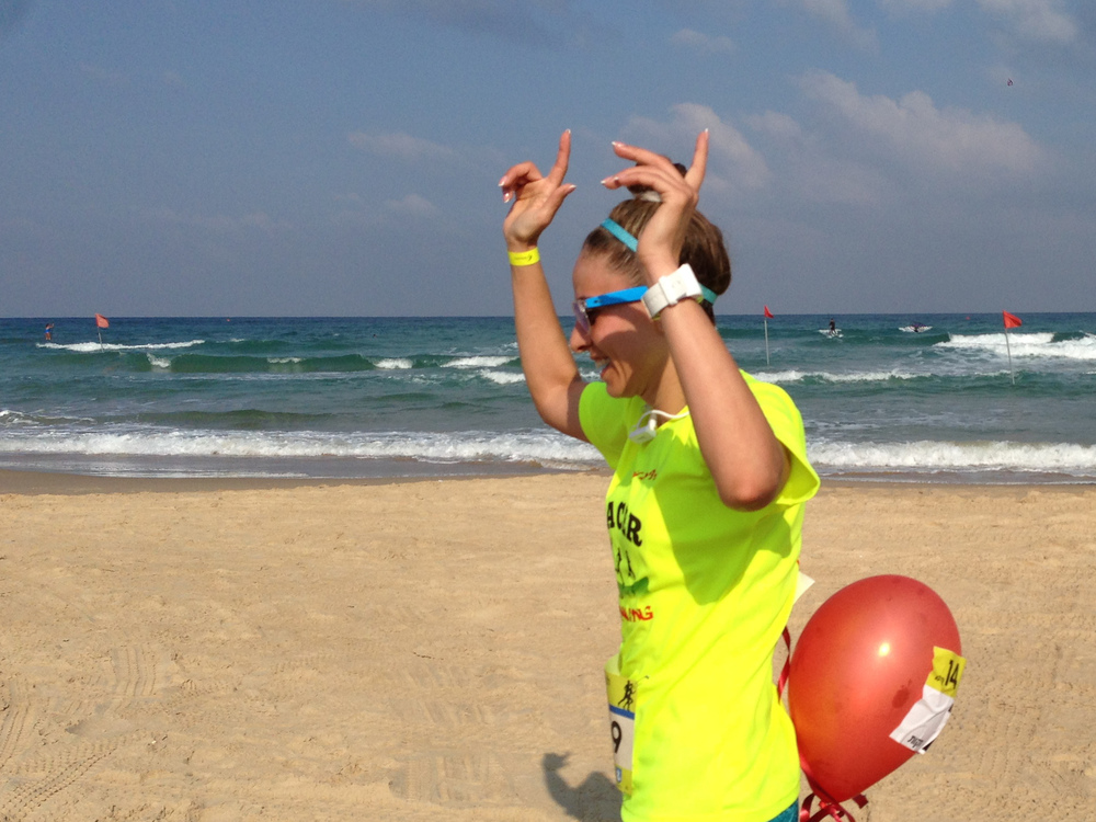Haneen Radi finishes a 14 kilometer race in the Israeli beach town of Netanya. Because of the reaction of conservative Muslims to her running clothes, she usually runs in Jewish areas.