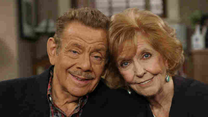 In this Nov. 6, 2003, file photo, Jerry Stiller and his wife Anne Meara pose on the set of The King of Queens, at Sony Studio in Culver City, Calif. Meara, whose comic work with Stiller helped launch a 60-year career in film and TV, has died. She was 85. Jerry Stiller and son Ben Stiller say Meara died Saturday, May 23, 2015.