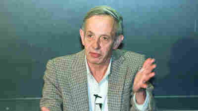 Princeton University professor John Nash speaks during a news conference at the university in Oct. 1994 after being named the winner of the Nobel Peace Prize for economics.