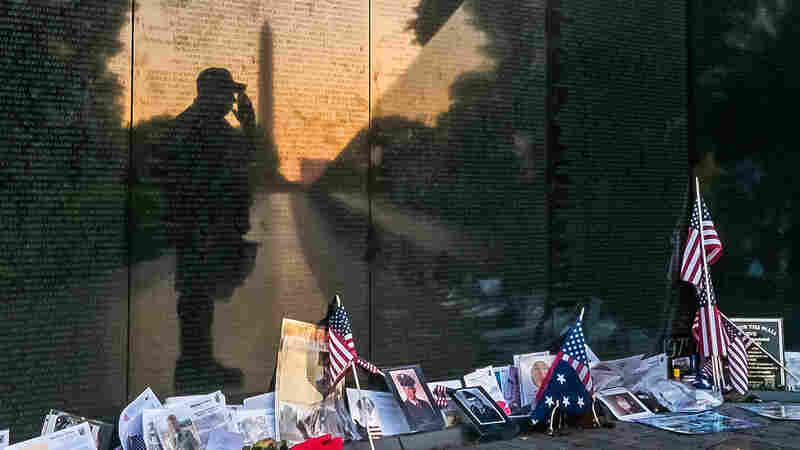 """Army veteran Bernie Klemanek, of Mineral, Va., stops to salute his fallen comrades on Memorial Day during an early morning visit today to """"The Wall"""" at the Vietnam War Memorial in Washington."""