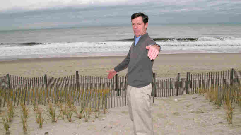 Thacher Brown stands at the edge of the dune behind his Bay Head, N.J., home in November. Brown, who rebuilt a dune in front of his house after Superstorm Sandy, says he opposes Gov. Chris Christie's plan to widen beaches and build dunes along the state's 127-mile coastline.