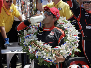 Juan Pablo Montoya, of Colombia, celebrates after winning the 99th running of the Indianapolis 500 at Indianapolis Motor Speedway on Sunday.