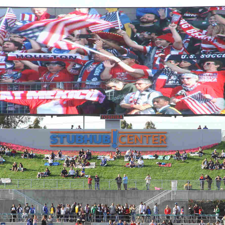 American Outlaws, seen on the big screen, cheer for the U.S. women's national team more than half an hour before kickoff during a match with Mexico on May 17.