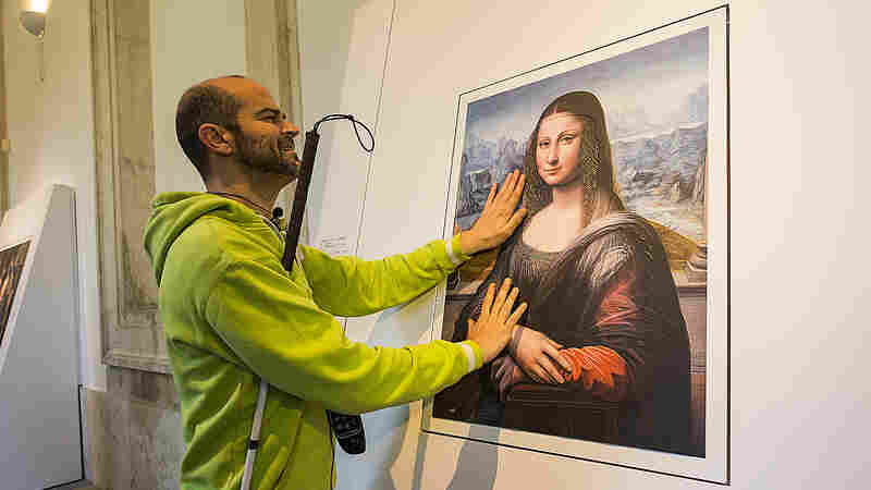 A blind visitor to Spain's Prado Museum runs his fingers across a 3-D copy of the Mona Lisa, painted by an apprentice to Leonardo da Vinci.