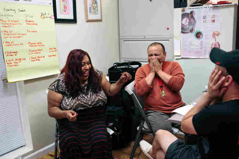 Ruby Corado and Paty Hernandez (center) talk to Jocelyn Carrillo (right) at Casa Ruby. Corado was encouraging Carillo, a drag queen in the city, to have her fans get involved with outreach and advocacy for transgender people.
