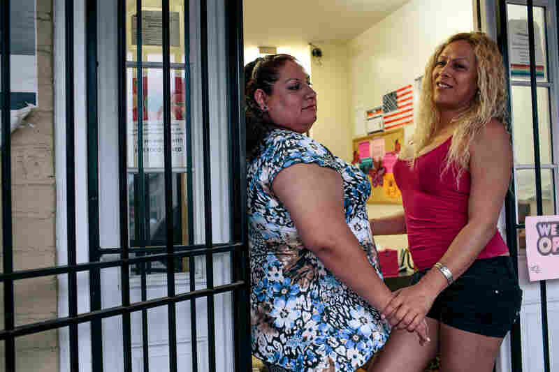 Lissa Alfaro, 34, (right) and volunteer Vanessa Arevalo, both originally from El Salvador, spend time at Casa Ruby.