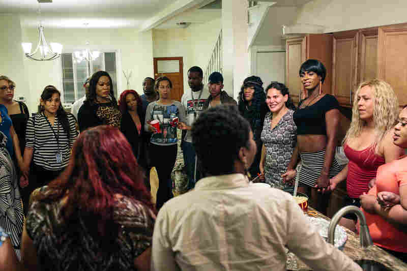 Ruby Corado (foreground left) speaks to her friends and clients before a group dinner on May 5.
