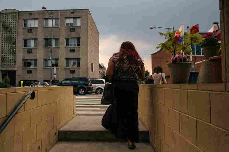 Ruby Corado walks out onto Georgia Avenue from inside Casa Ruby, a drop-in and service center she founded for transgender people in Washington, D.C.
