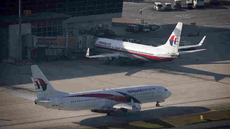Malaysia Airlines planes sit on the tarmac last year at the Kuala Lumpur International Airport in Sepang, Malaysia.