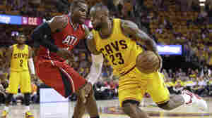 Cleveland Cavaliers forward LeBron James drives to the lane Tuesday night against Atlanta Hawks forward Paul Millsap,