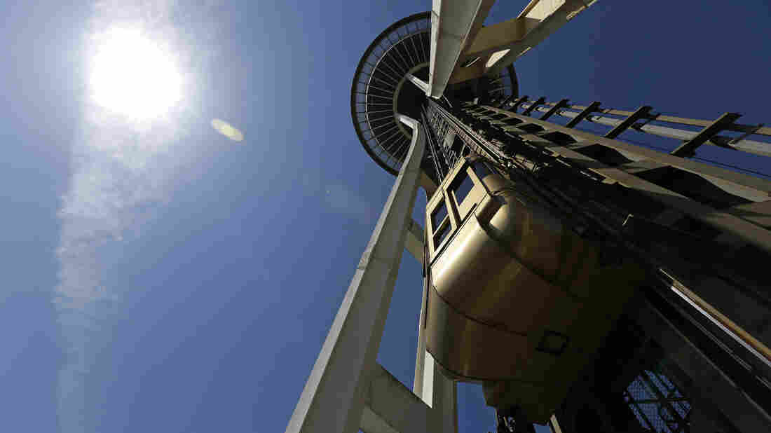 Seattle Space Needle elevator operator Michael Hall says despite the success of the attraction, his pay hasn't budged in four years.