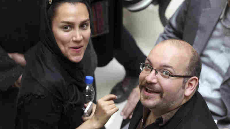 A 2013 photo shows Washington Post reporter Jason Rezaian and his wife, Yeganeh Salehi, a correspondent for the Abu Dhabi-based newspaper The National. Both of them were in an Iranian court Tuesday.