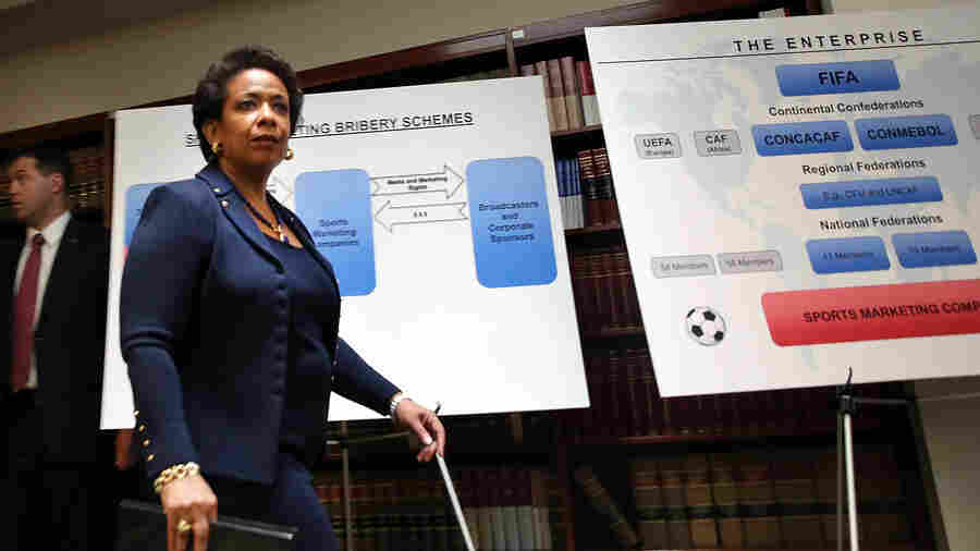 Attorney General Loretta Lynch enters a packed news conference at the U.S. Attorneys Office of the Eastern District of New York following the early morning arrest of world soccer figures, including officials of FIFA, for racketeering, bribery, money laundering and fraud on Wednesday.