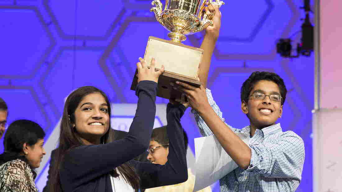Vanya Shivashankar, left, of Olathe, Kan., and Gokul Venkatachalam of Chesterfield, Mo., lift the trophy after becoming co-champions Thursday night after the final round of the 88th annual Scripps National Spelling Bee at National Harbor in Maryland.