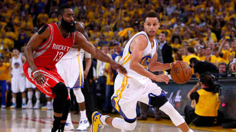 Stephen Curry of the Golden State Warriors drives on James Harden of the Houston Rockets in the second half of the