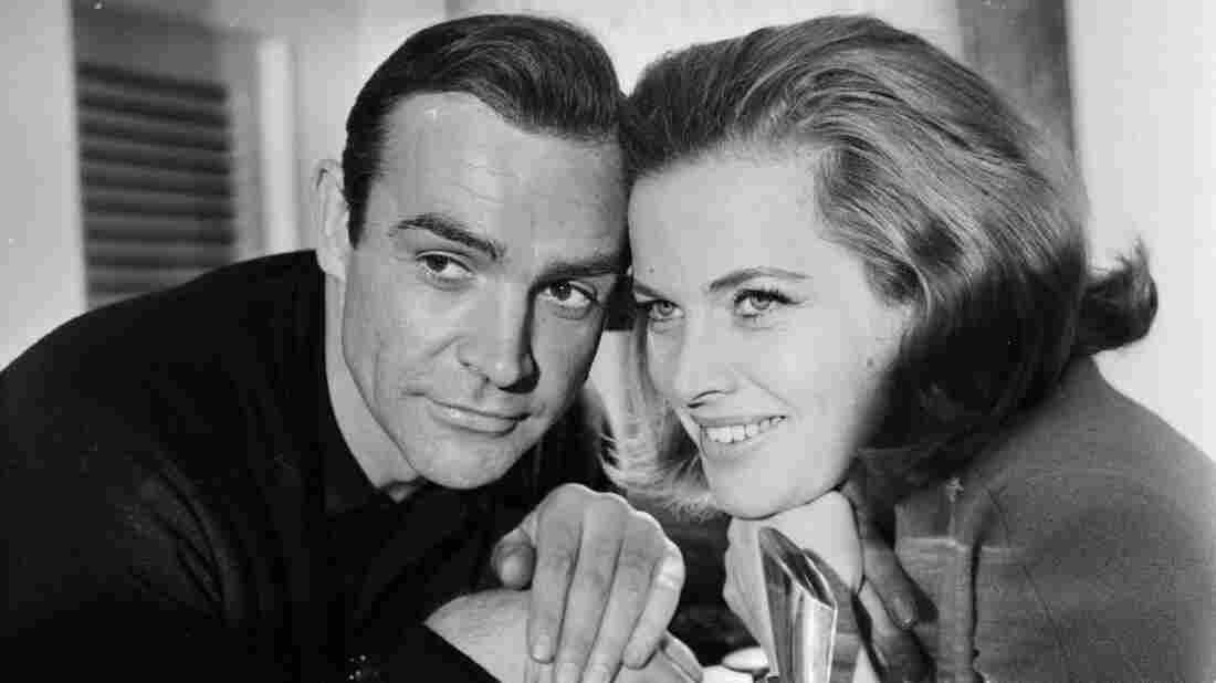 A return to Pussy Galore's golden days: Honor Blackman, who played the character on screen in Goldfinger, poses with the original Bond, Sean Connery.