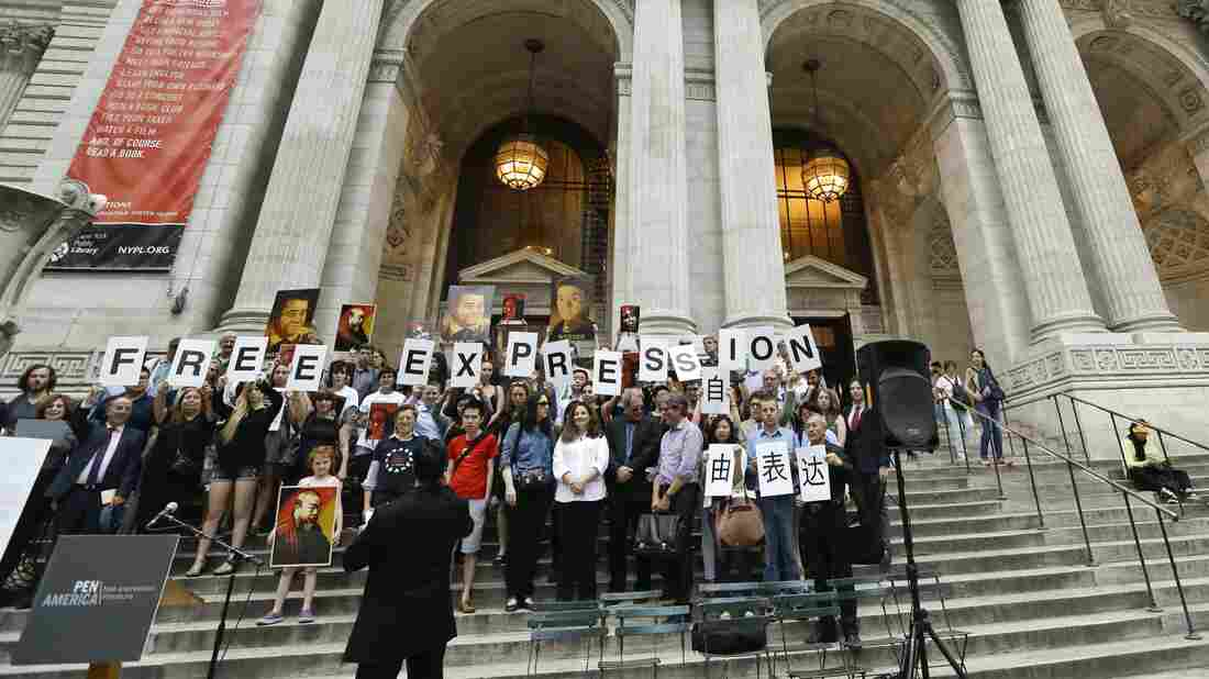 Protesters gathered on the steps of the New York Public Library on Wednesday to show support for silenced Chinese writers.
