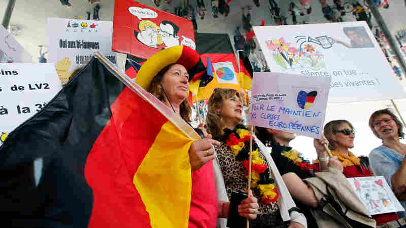 Striking French teachers hold a German flag as they take part in a nationwide protest against new measures aimed at revamping the country's school system, in Marseille, France, on May 19. France's 840,000 teachers are largely opposed to the reform, their unions say, fearing it will increase competition between schools and exacerbate inequalities.