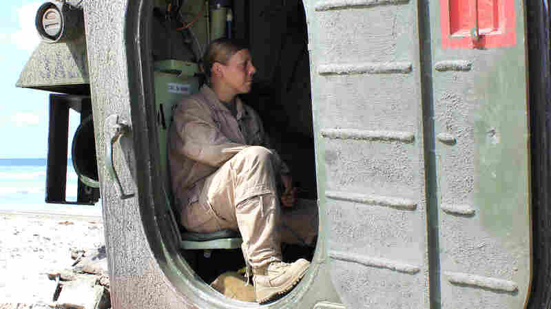Sgt. Cassie McDole sits in an AAV.