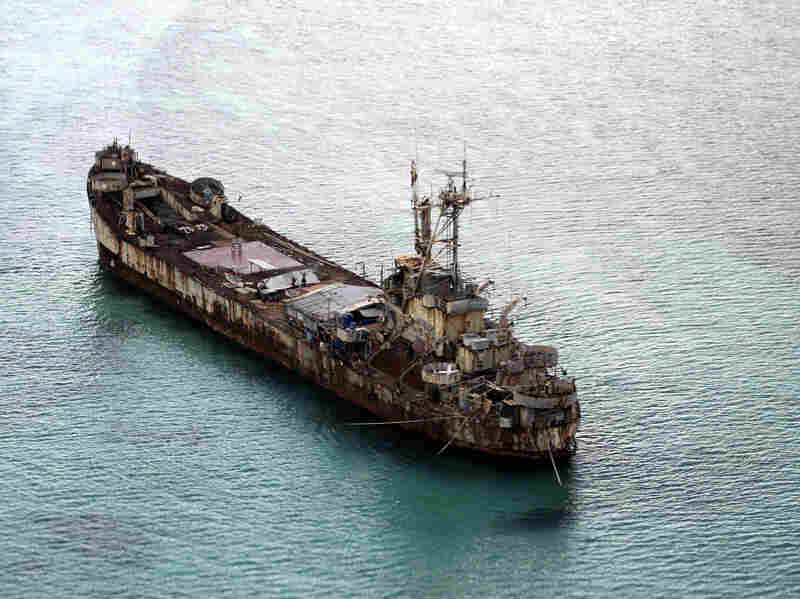 This aerial photo taken through the window of a military plane shows the dilapidated Sierra Madre ship of the Philippine navy anchored near Ayungin Shoal with Filipino soldiers onboard to secure perimeter in the Spratly Islands on May 11.