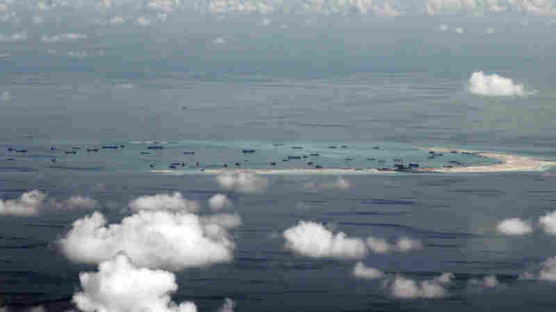 This aerial photo taken through a glass window of a military plane shows China's alleged ongoing reclamation of Mischief Reef in the Spratly Islands in the South China Sea on May 11.