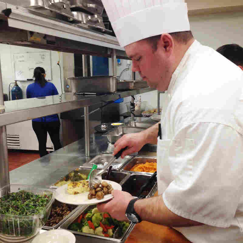 """Corradetti in the kitchen at Bethlehem Woods, where fresh vegetables, fruit, dairy products and meat abound.""""We don't use a ton of frozen product here,"""" he says."""