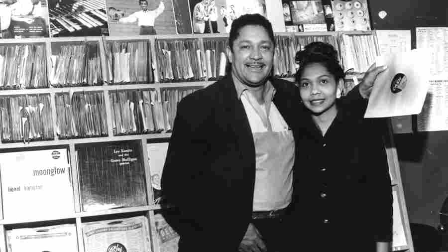John Dolphin and his wife Ruth Dolphin pose in his record store around 1958.