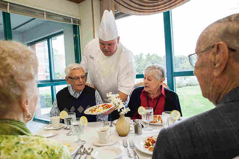 Chef Eric David Corradetti presents dinner to residents at the Bethlehem Woods senior living facility in La Grange Park, Ill. His kitchen emphasizes fresh produce and meats and meals made from scratch.