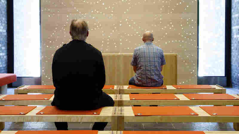 Two men sit inside the chapel at Halden prison in far southeast Norway in this picture taken in 2010. Prisoners here spend 12 hours a day in their cells, compared to many U.S. prisons where inmates spend all but one hour in their cell.