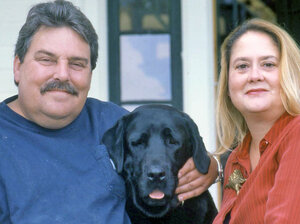 Vermont artists Stephen and Gwen Huneck loved their dogs, including Sally, pictured here with them in 2003. Sally was the inspiration for many of Stephen's carvings and best-selling children's books.