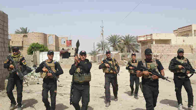 Iraqi anti-terrorism forces patrol in central Ramadi, Iraq, on April 18. A month later, the city fell to the self-declared Iraqi State. Ayman Oghanna, a journalist who was embedded with Iraqi Special Forces in the city, says the Special Forces are capable precision fighters — but are being asked to fill the role of an entire military.