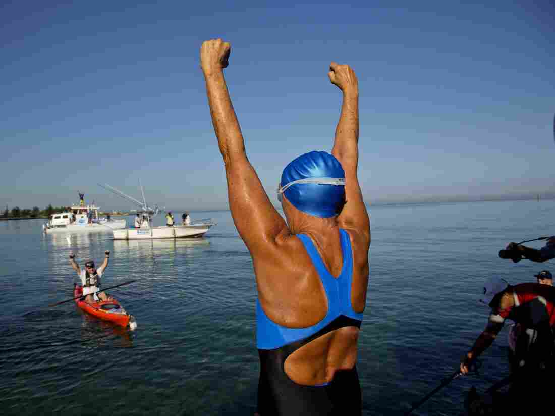 Diana Nyad, 64, greets her support team on Aug. 31, 2013, before her successful swim to Florida from Havana.