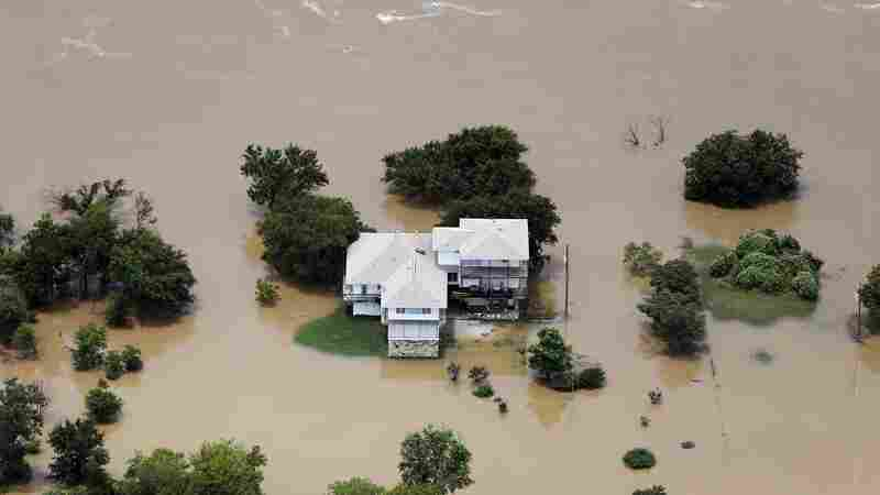 Flood waters from the Brazos River encroach upon a home in the Horseshoe Bend neighborhood in Weatherford, Texas, on Friday.
