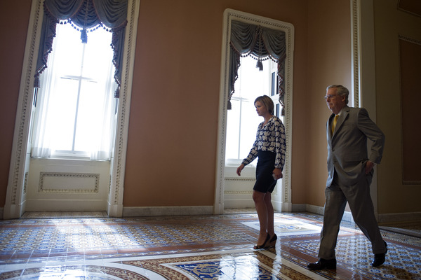 Senate Majority Leader Mitch McConnell, R-Ky., walks from the Senate chamber after opening a special session to extend surveillance programs in Washington on Sunday.